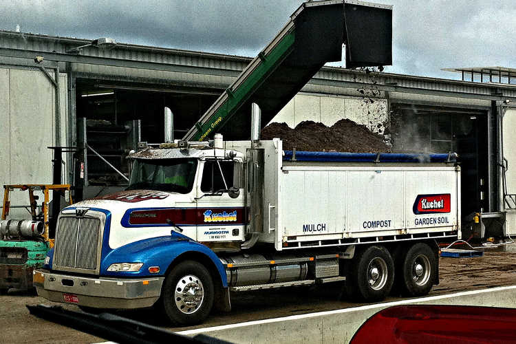 Loading mushroom compost into truck