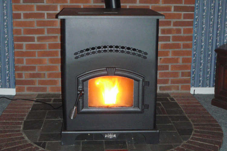 Freestanding pellet stove on hearth