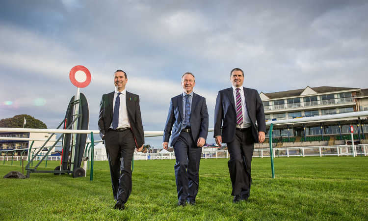 Business executives at racecourse