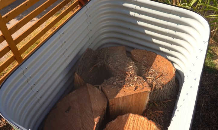 Adding logs to the raised bed